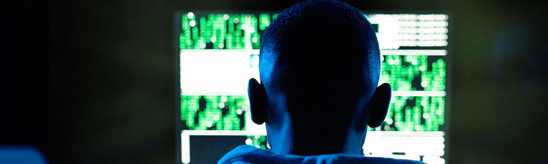 Young man looking at computer screen